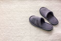 Room Slippers are on a soft rug, the concept of comfort and convenience royalty free stock photos