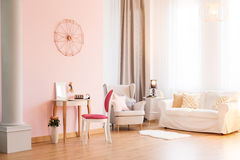 Room with sofa and armchair. Pink room with sofa, armchair and dressing table Stock Images
