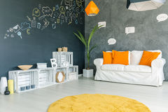 Room with sofa and carpet. Room with white sofa, orange pillows and yellow carpet Stock Photography