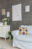 Room with sofa and dresser. Cozy grey room with light sofa and dresser royalty free stock photography