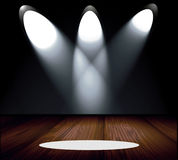 Room With Spotlights. Empty room interior with three bright spotlights shining down onto the wood stage floor Stock Images