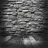 Room with stone walls and wooden floors Royalty Free Stock Images