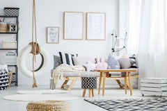 Room with swing. Trendy scandi white room with simple tire swing Royalty Free Stock Image