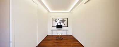 Room with table chair and computer Royalty Free Stock Image