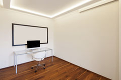 Room with table chair and computer Stock Images