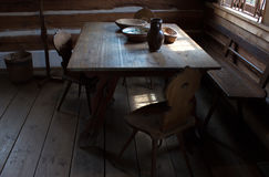 Room with table on the old weekend cottage Stock Images