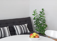 Room with table, sofa and green tree Stock Images