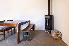 Room with table and wood stove Royalty Free Stock Images