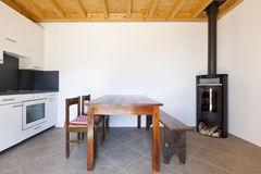Room with table and wood stove Stock Photo