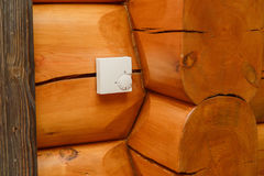 Room temperature controller for heating and cooling on a wall in a wooden house. Stock Image