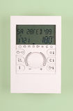 Room thermostate. Indoor temperature thermostat, turned on set on 18 degrees celsius Stock Photo