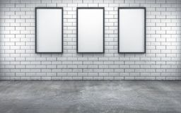 Room with three blank frames on white wall. 3d rendering Royalty Free Stock Photography