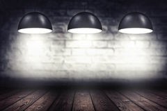 Room with three spotlight lamps Royalty Free Stock Photography