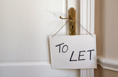 Room to let sign. Hanging on a door handle stock photo