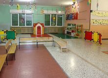 Room with toys in a kindergarten. Wide hall with toys for children in a kindergarten stock images