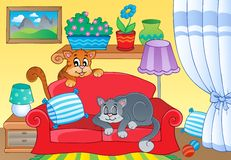 Room with two cats on sofa Royalty Free Stock Photography