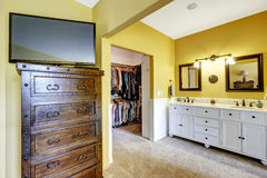 Room with vanity cabinet and walk-in closet Stock Photos