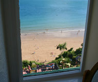 Room with a view. Tenby hotel room view looking out to the beach royalty free stock photography