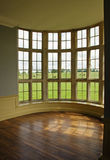 Room with a view. A magnificent window in an empty mansion royalty free stock images