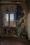 Room with a view. View into the desert out of an abandoned house in the ghost town Kolmanskop, Namibia royalty free stock photo