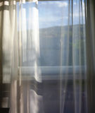 Room with a view. View through curtain Royalty Free Stock Image