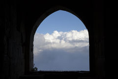 A room with a view. Black silhouette of a window frame in fort of Krak des Chevalliers - Syria stock images