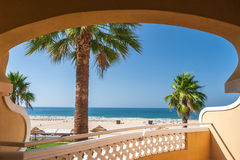 Room with a view. Hotel room with view on the beach in summer Stock Image