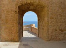A Room With A View In A Castle - Sea View Through An archway tunnel Royalty Free Stock Images