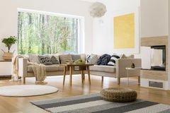 Room with a view. Modern designed living room with a pretty view through the window Stock Photography