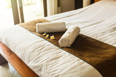 Room in villa, towel on the bed royalty free stock images
