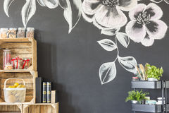 Room wall with flower motive. Room with black wall with flower motive royalty free stock images