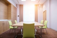 Room in which business meetings, conferences can be held. Bright room in which business meetings, conferences can be held Stock Photography
