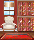 Room with white armchair and bookshelves Stock Photo
