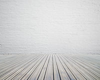 Room with white brick wall with wooden floor Royalty Free Stock Images