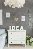 Room with white dresser. Room with decorative grey wall finish and white dresser stock images