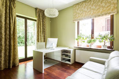 Room with white leather couch Stock Images