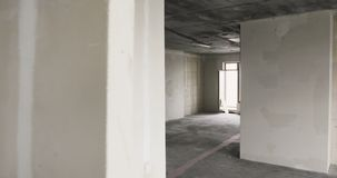 Empty sunny room without finishing in new apartment house. stock footage