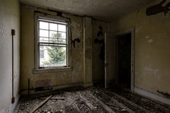 Room with Window - Abandoned Hospital / Sanitarium - New York. An interior view of a room with a window inside an abandoned hospital in New York stock images