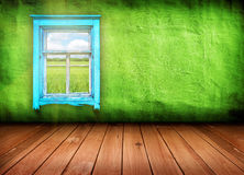 Room with window with field and sky above it Stock Photo
