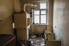Room with window and old destroyed furniture in creepy abandoned hospital. Room with window and old destroyed furniture in creepy abandoned Soviet hospital royalty free stock images