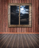 Room with a window wall floor, the night sky outside the window, Stock Photos