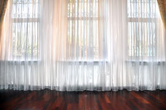 Room window with white, yellow and orange curtains Royalty Free Stock Images