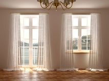 Room with windows and balcony door. Empty room with a wonderful view from the windows and balcony door which are decorated with white curtains Royalty Free Stock Photography