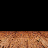 Room with wooden floor and black wall Royalty Free Stock Images