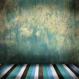 Room with wooden floor. And green exposed concrete wall Royalty Free Stock Images