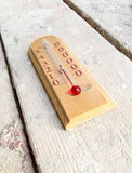 Room wooden thermometer on boards with cement Royalty Free Stock Image