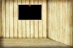 Room with wooden wall and blackboard Stock Photo