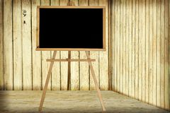 Room with wooden wall and blackboard Royalty Free Stock Image