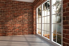 Room in the woods. Brick room with large window in a forest Stock Photo