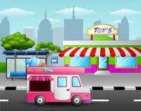 Roomijsvrachtwagen voor de stuk speelgoed winkel dichtbij een straat Stock Foto's